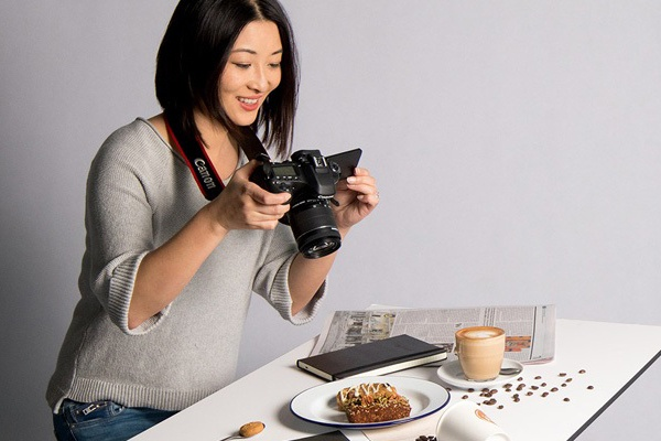 Picture of Canon Camera taking photos of coffee and food