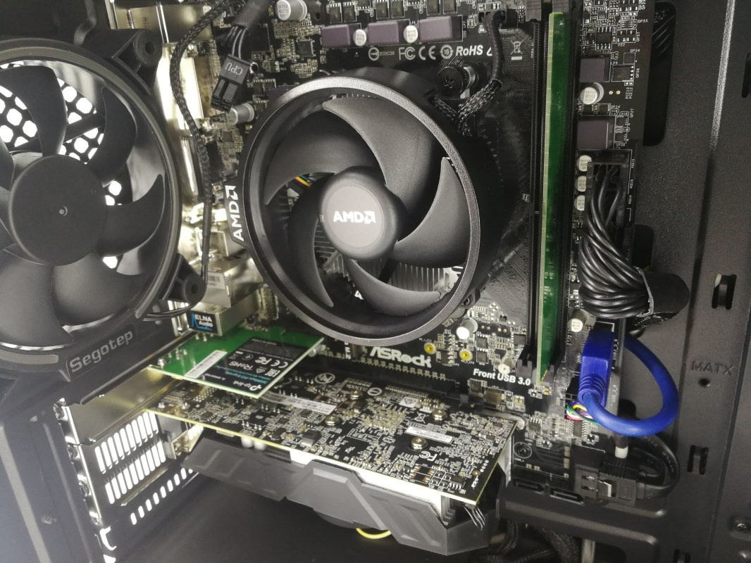 Picture of the inside of PC showing CPU, RAM and Graphics card connected to the motherboard