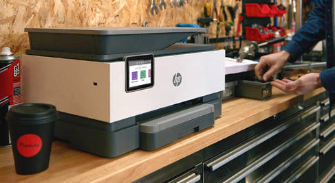 Picture of an HP printer on a workbench