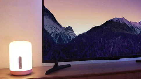 Mi bedside lamp next to a TV