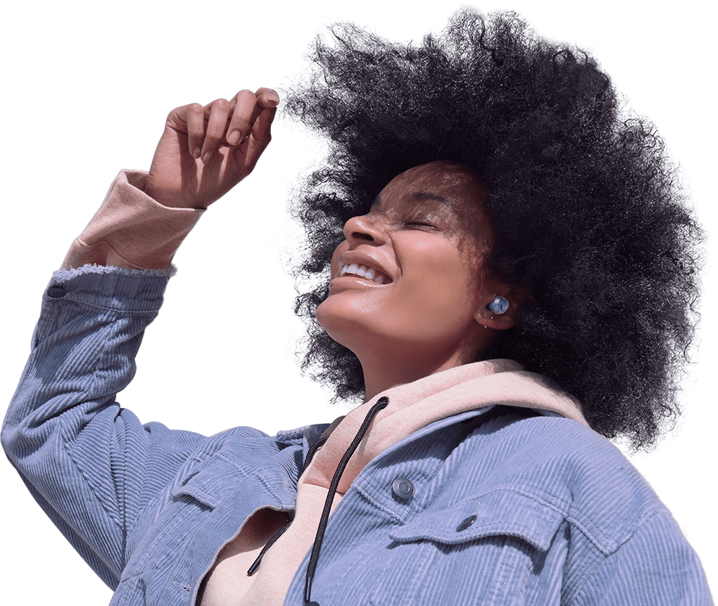 A woman wearing Galaxy Buds Pro. She is dancing and clearly enjoying the music she's listening to. Rings appear around her, expanding until the background is blocked. These rings represent the noise blocking that Intelligent ANC delivers.