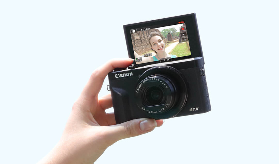 The Canon PowerShot G7-X MK III being used take a selfie.
